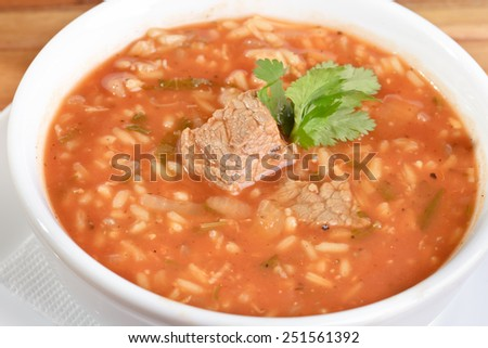Soup with meat and rice - stock photo