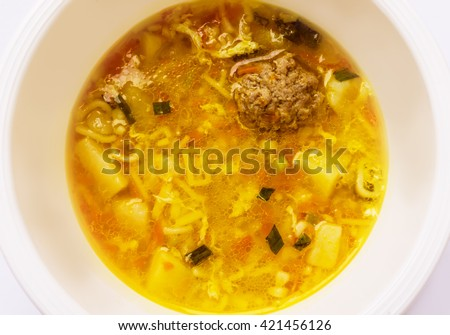 Soup with meatballs. - stock photo
