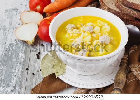 soup with meatballs and rice on the kitchen table. delicious lunch.  - stock photo