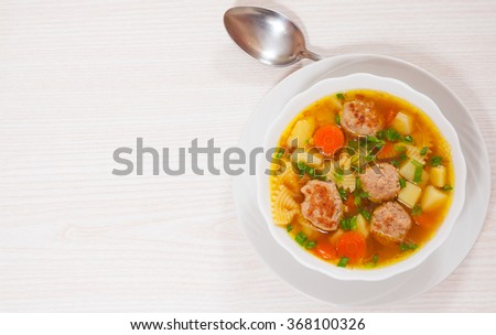 Soup with meatballs, farfalle pasta and vegetables - stock photo