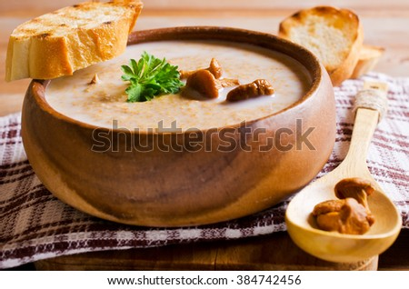 Soup with mushrooms and cream in a bowl. Selective focus. - stock photo