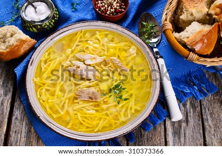 Soup with pasta, meat and vegetables in a ceramic bowl - stock photo