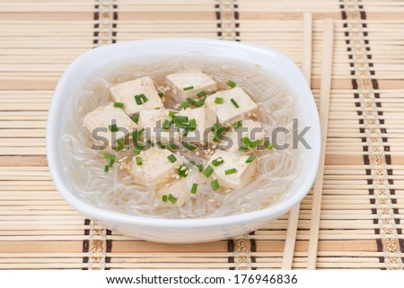 soup with rice noodles and tofu, close-up - stock photo