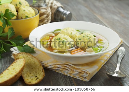 Soup with turkey meatballs in the plate on the table - stock photo