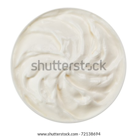 Sour cream in small round plate, isolated on white - stock photo