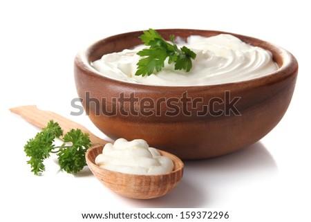 Sour cream isolated on white - stock photo