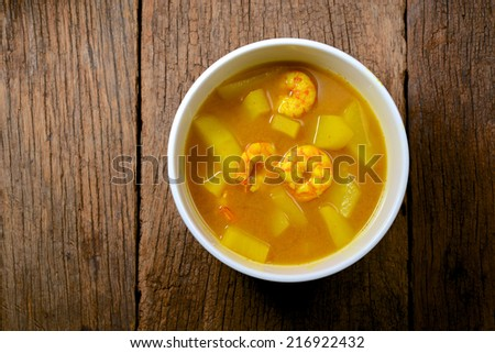 sour soup made of tamarind paste with shrimp and papaya, Thai food - stock photo