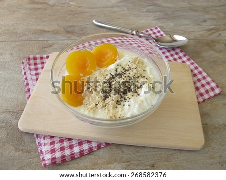 Soured milk with apricots, cereals and chia seeds - stock photo