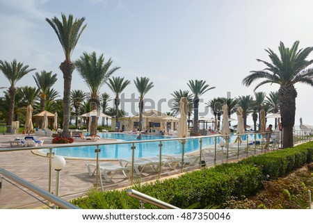 SOUSSE,TUNISIA - JULY 2,2016: tourists at the pool in the hotel