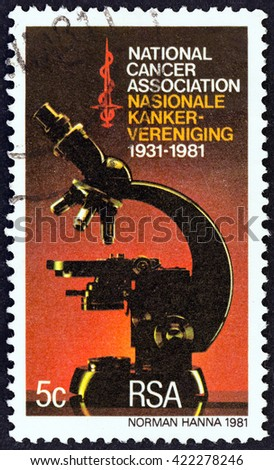 SOUTH AFRICA - CIRCA 1981: A stamp printed in South Africa issued for the 50th anniversary of National Cancer Association shows Microscope, circa 1981.  - stock photo