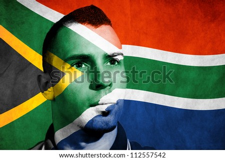 South Africa flag painted on his face. - stock photo
