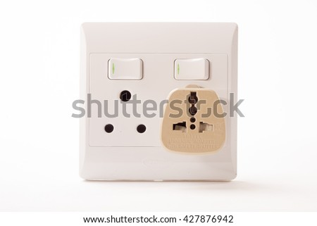 South African Electric Double Wall Plug with a universal travel adapter attached to it.