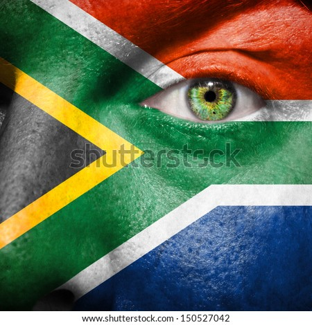 South African flag painted on a man's face to support his country South Africa - stock photo