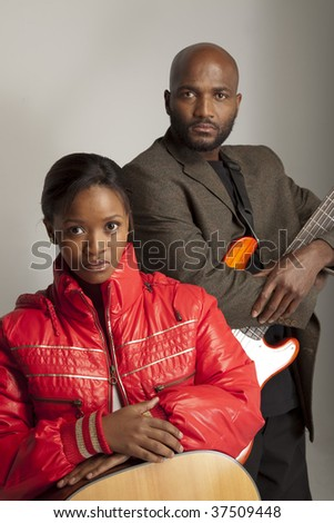 South African man and woman with musical instruments.