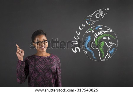 South African or African American black woman teacher or student with a good idea about world success standing against a chalk blackboard background inside - stock photo