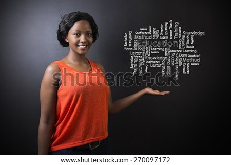South African or African American woman teacher or student against blackboard background with chalk education diagram - stock photo