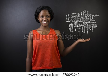 South African or African American woman teacher or student holding her hand out against a blackboard background with a chalk education diagram - stock photo