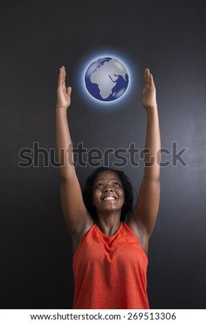 South African or African American woman teacher or student reaching for world earth globe on black background - stock photo