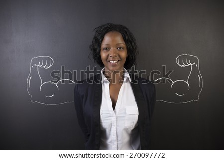 South African or African American woman teacher with healthy strong chalk arm muscles for success on blackboard background - stock photo