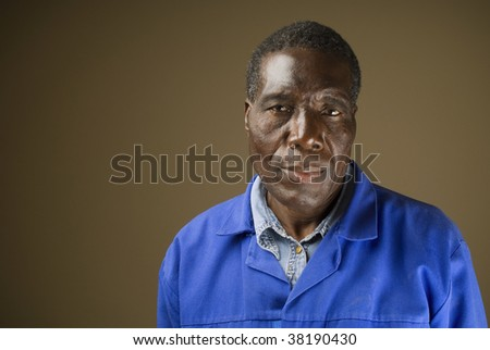 South African or American black senior worker or blue collar foreman portrait - stock photo