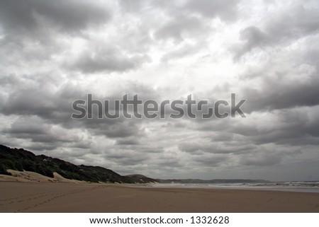 South African Wild Coast beach under a leaden sky - stock photo