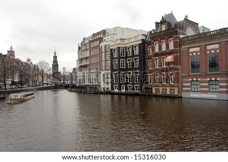 South Amsterdam with the clock tower and canals in Spring - stock photo