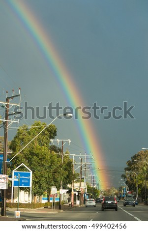 South Australia, Australia - October 12, 2016: A rainbow appears above Glen Osmond Rd, a Highway 1 road that serves as a direct route from Adelaide's city center to the Adelaide Hills