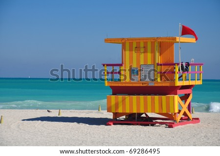 South Beach Miami Lifeguard Tower with Blue Water - stock photo