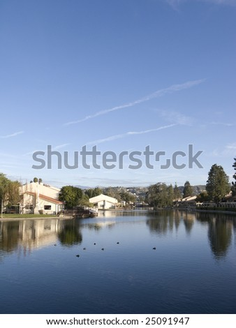 South California Lake Housing Community in front of Mountain Range