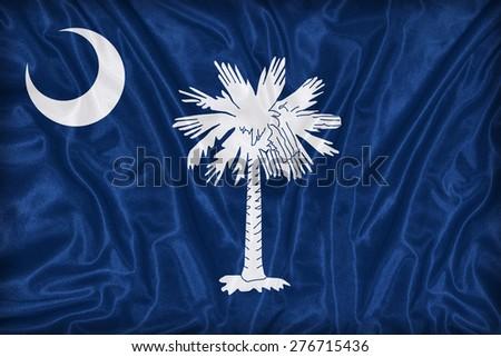 South Carolina flag on fabric texture,retro vintage style - stock photo