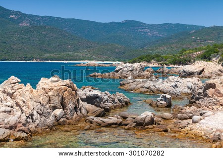 South Corsica, wild coastal landscape with stones in blue sea water. Selective focus on a foreground - stock photo