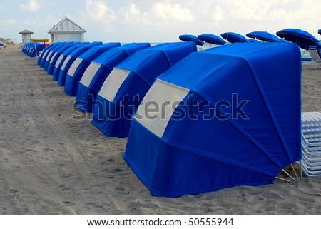 South Florida blue cabanas on beach - stock photo