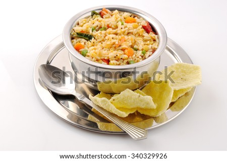 south Indian food sambar rice with fried chips - stock photo