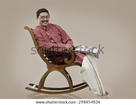 South Indian man sitting on a chair - stock photo