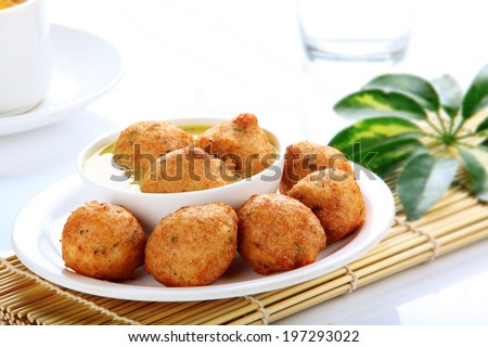 South Indian meal Bonda soup. This is usually served as breakfast or evening snack. - stock photo