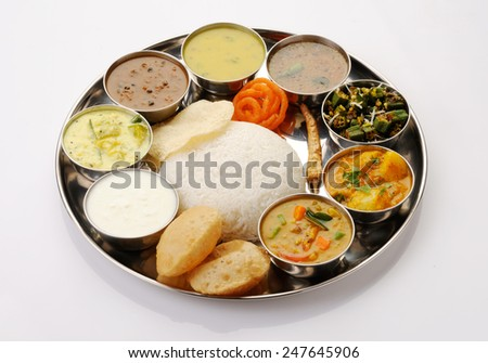 south Indian Thali served in marriages,vegetarian indian thali lunch,meals with rice, phulka(chapatti), puri(poori), curries, sambar, rasam, pulao, papad and sweets  Complete nutritional indian food - stock photo