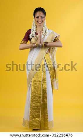 South Indian woman greeting - stock photo