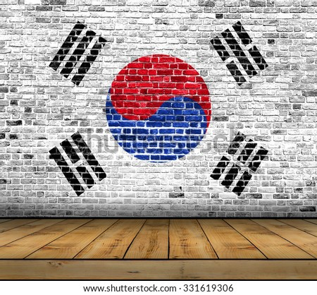 South Korea flag painted on brick wall with wooden floor - stock photo