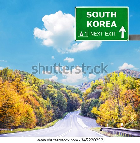 SOUTH KOREA road sign against clear blue sky - stock photo
