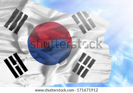 South Korea waving flag against blue sky with sunrays - stock photo