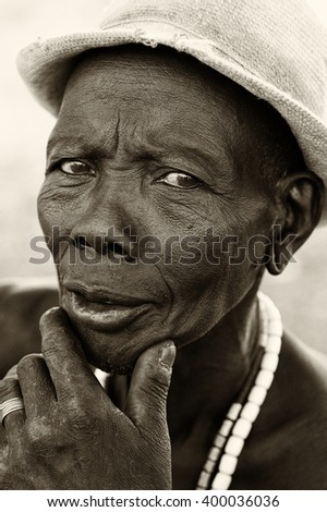 SOUTH OMO - ETHIOPIA - JULY 21, 2014: Unidentified elderly Mursi man on July 21, 2014 in South Omo, Ethiopia. A 5-year ongoing resettlement program started 2011 threatens the tribes in Ethiopia. - stock photo