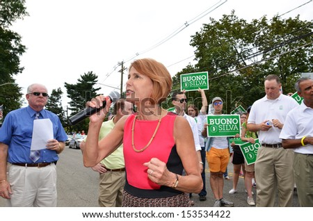 SOUTH PLAINFIELD,NJ-SEPTEMBER 2: Gubernatorial Candidate Senator Barbara Buono energizes parade-goers during the 56th Annual Labor Day Parade on September 2,2013 in South Plainfield,N.J. - stock photo