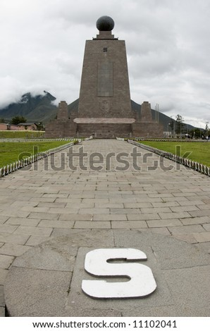 south side line monument at mitad del mundo middle of the earth equator ecuador - stock photo