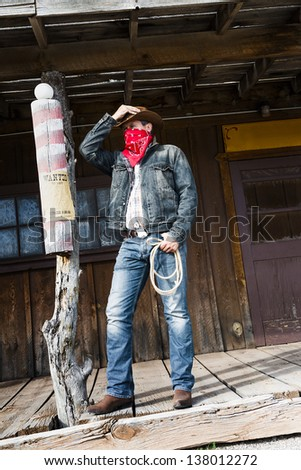 SOUTH WEST - A cowboy takes time to rest and reflect. - stock photo