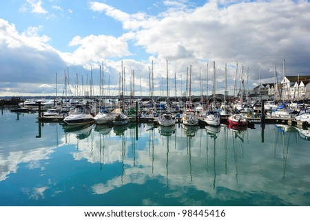 """SOUTHAMPTON - MAR 18: Yachts at a harbor in Southampton on March 18, 2012. Yacht racing is a popular sport along the South Coast of England. The best-known event is """"Clipper 11-12"""" in Southampton. - stock photo"""