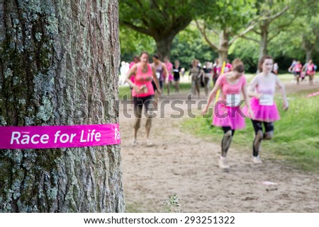 SOUTHAMPTON, UK - JULY 4 : Women gather for the annual Race for Life Pretty Muddy fun run, to raise money for Cancer Research. 4 July 2015 in Southampton, UK. - stock photo