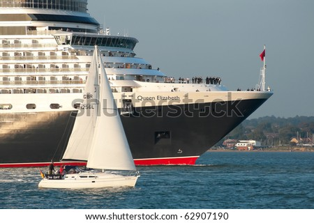 SOUTHAMPTON, UK - OCT 12: Queen Elizabeth cruise liner leaves port at sunset on her maiden voyage. Oct 12, 2010, Southampton, UK.