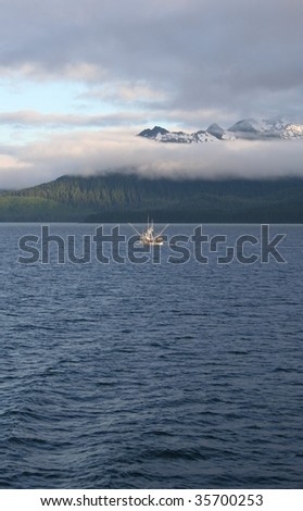 Southeast Alaskan landscape with commercial salmon fishing boat - stock photo