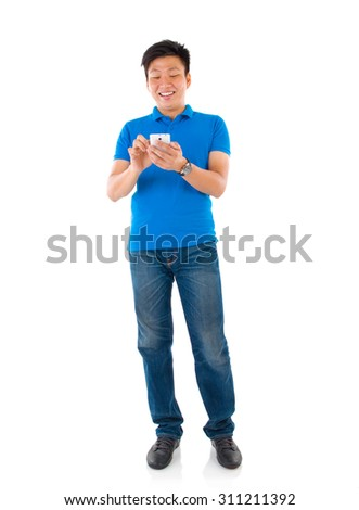 Southeast Asian business man on smartphone communication - stock photo