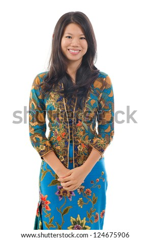 Southeast Asian woman in traditional batik kebaya clothing, isolated white background